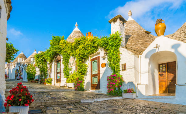 the traditional trulli houses in alberobello city, apulia, italy - cupola stock pictures, royalty-free photos & images