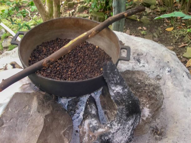 The traditional way that small villages roast coffee beans for resale and to monetize their agriculture. stock photo
