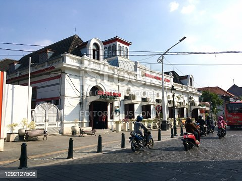 The view of a heritage architecture Post Office (Kantor Pos) building in Semarang, Indonesia with the traffic from motorcycles at the front