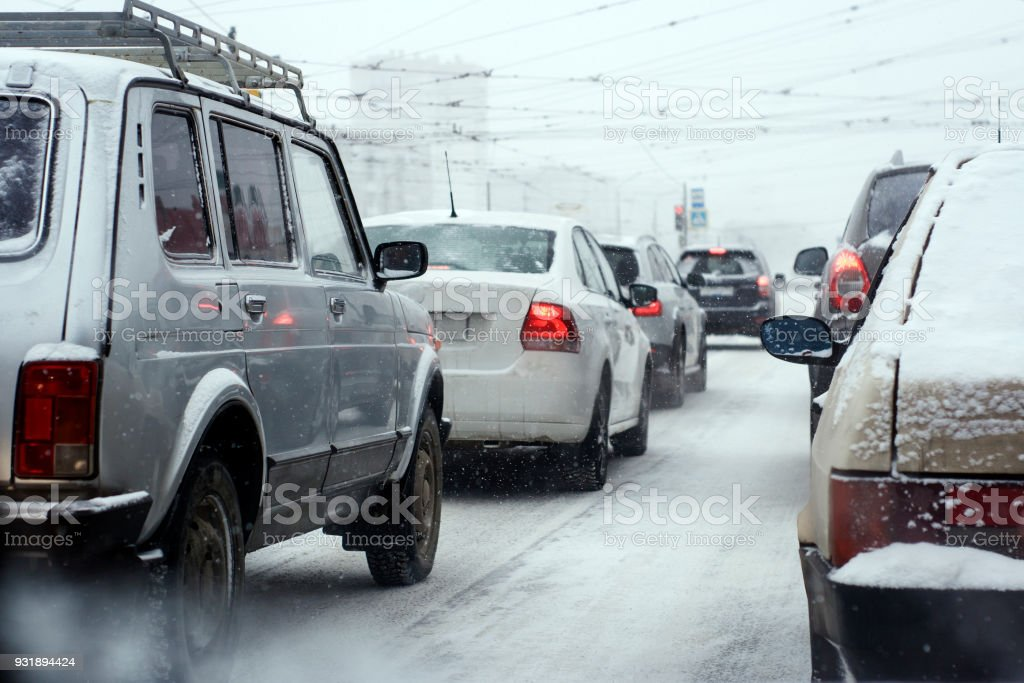 The traffic jam on the city's main street in winter stock photo