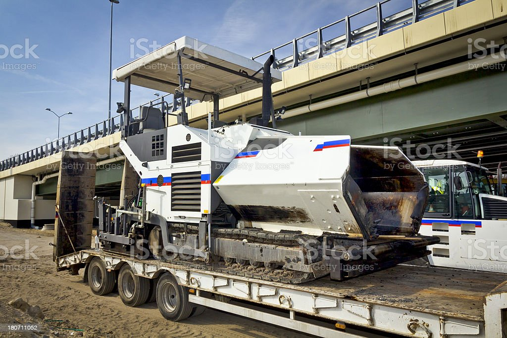 The trailer platform with Asphalt paving machine royalty-free stock photo