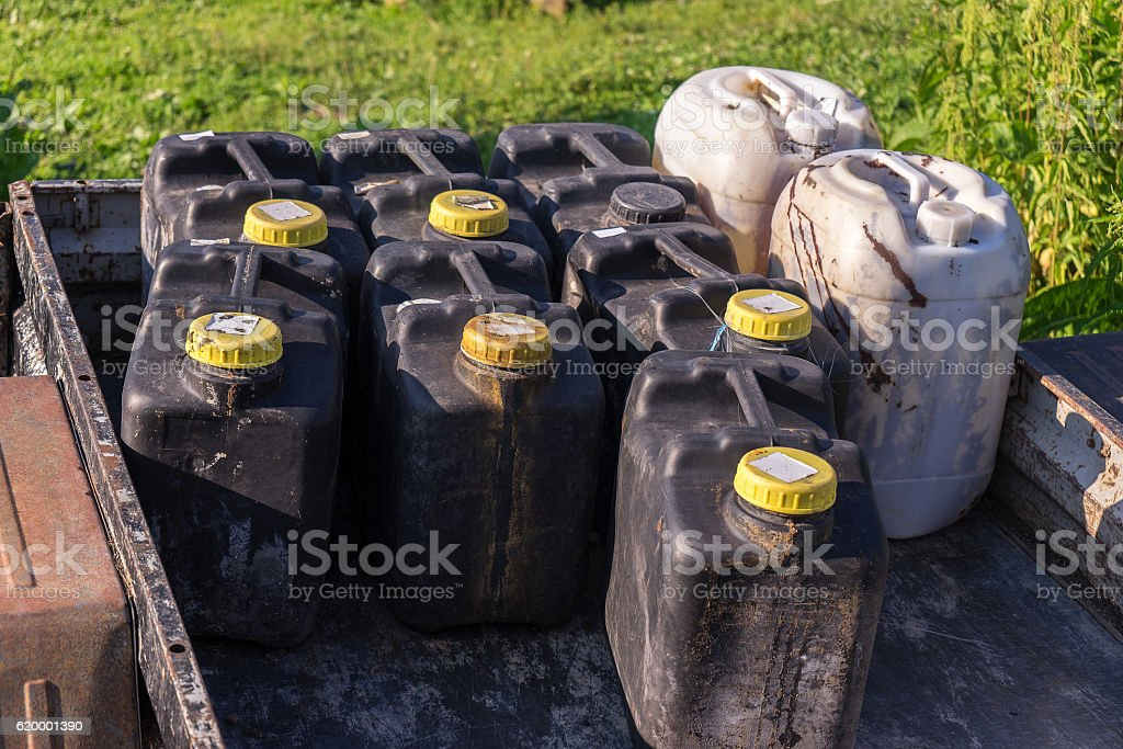 the trailer with black dirty cans stock photo