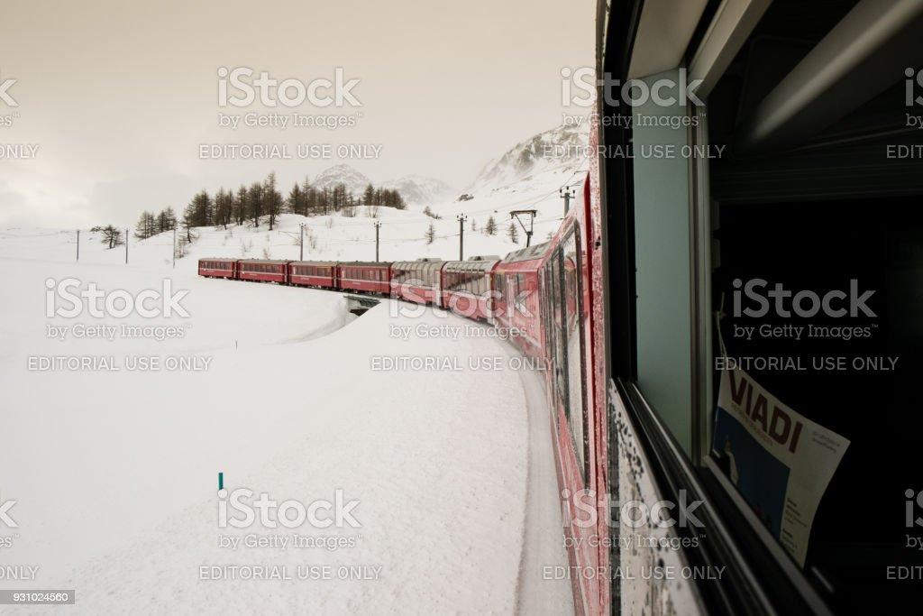 The train Bernina Express crosses the Swiss alps stock photo