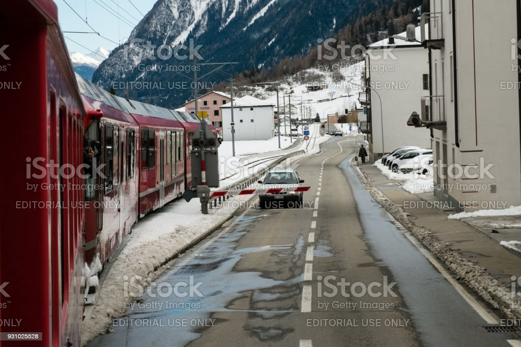 The train Bernina Express crosses the village stock photo