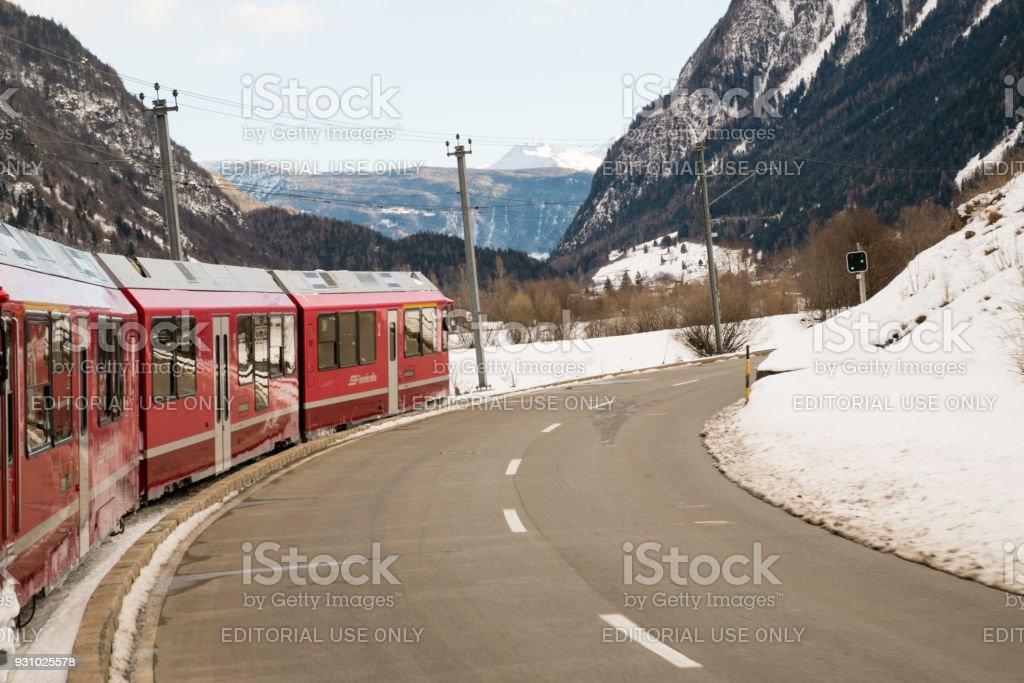 The train Bernina Express near the road stock photo
