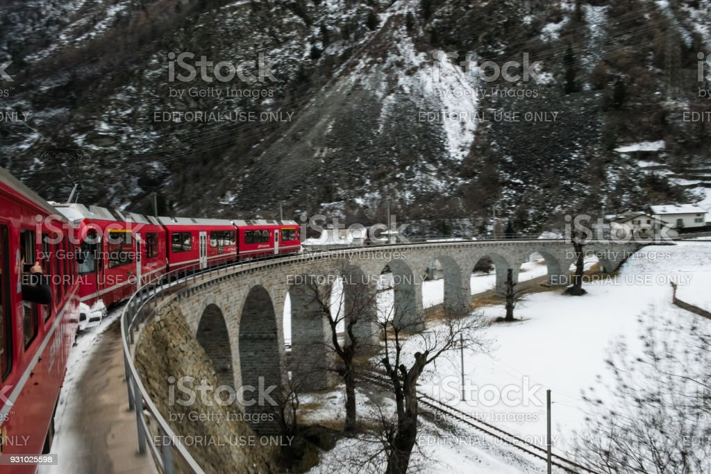 The train Bernina Express over the spiral viaduct stock photo