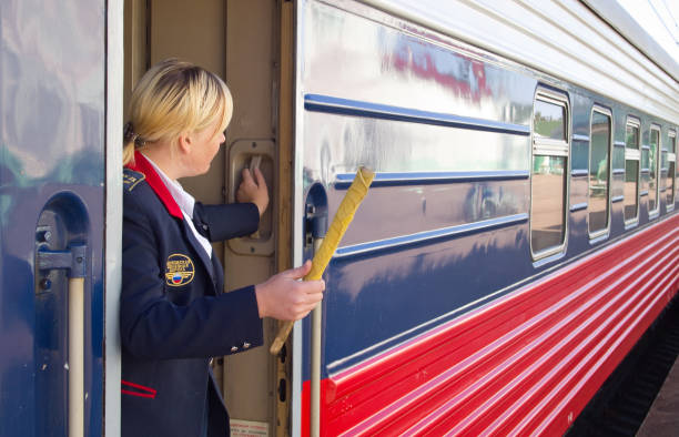 the train conductor gives a signal for the departure - transport conductor stock photos and pictures
