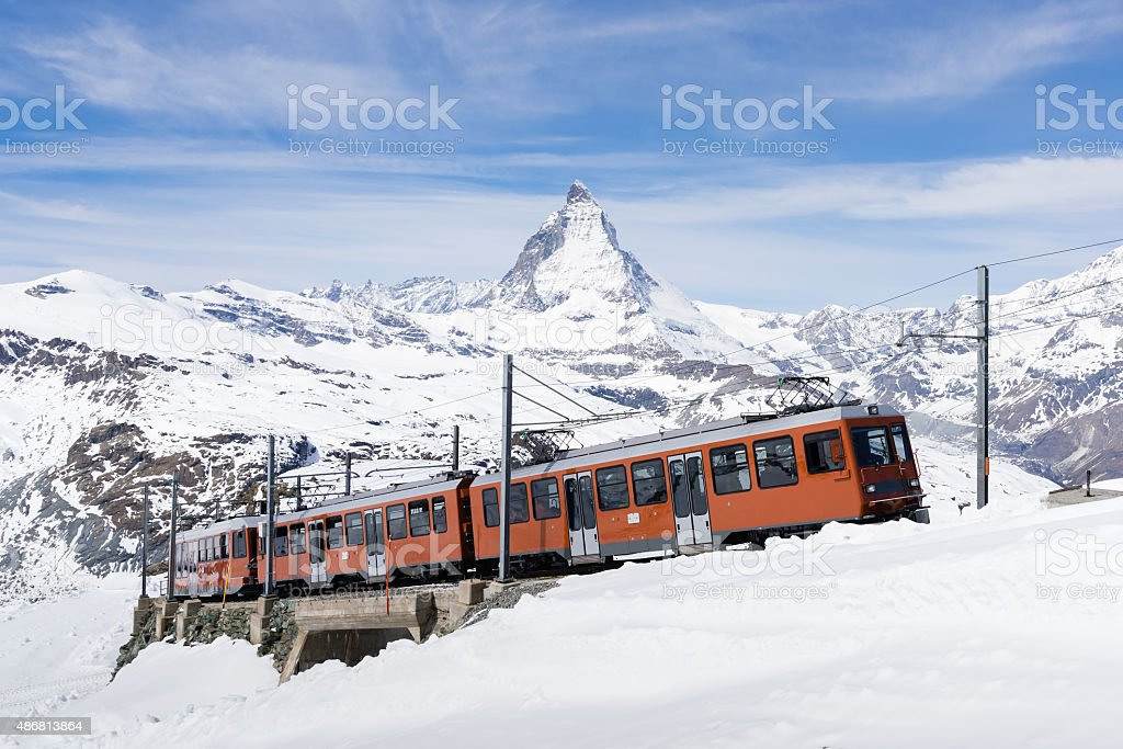 The train running to the  station with Matterhorn. stock photo