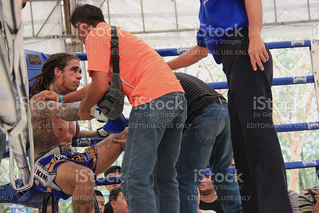 The trainers were giving advices to the Thai Boxer. stock photo