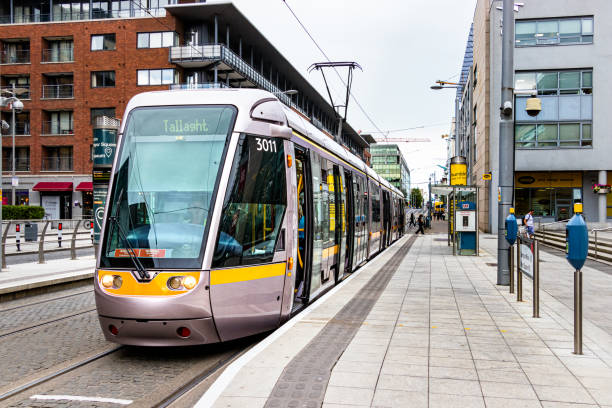 The tram Luas direction Taliaght stopped on a station in Dublin, Ireland stock photo