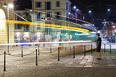 Milan, Italy - July 21, 2015: summer night view of a typical public tram in Milan city. Long exposure with blurred motion panning. Photo taken in a public place.