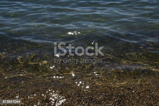 1037450870 istock photo The transparent sea water near the shore 615841044