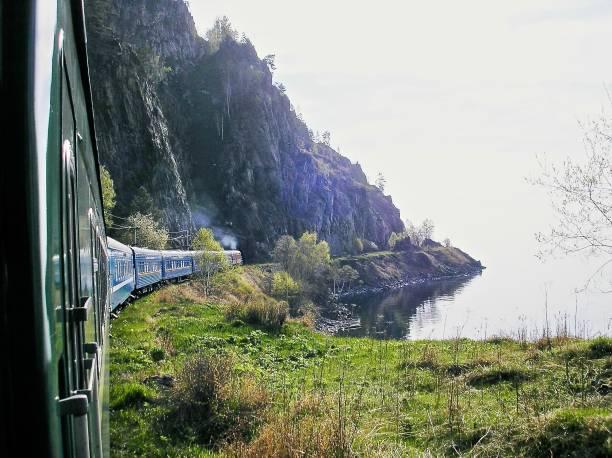 the trans-siberian express skirts lake baikal - сибирь стоковые фото и изображения