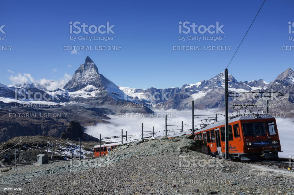 The travel train to Gonergrat bahn running through the railway with the beautiful Matterhorn mountain in the background in autumn stock photo