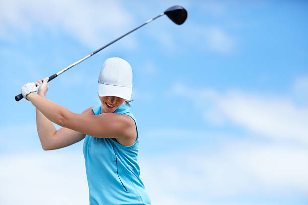 the trick is to keep your head down - female golfer stock photos and pictures