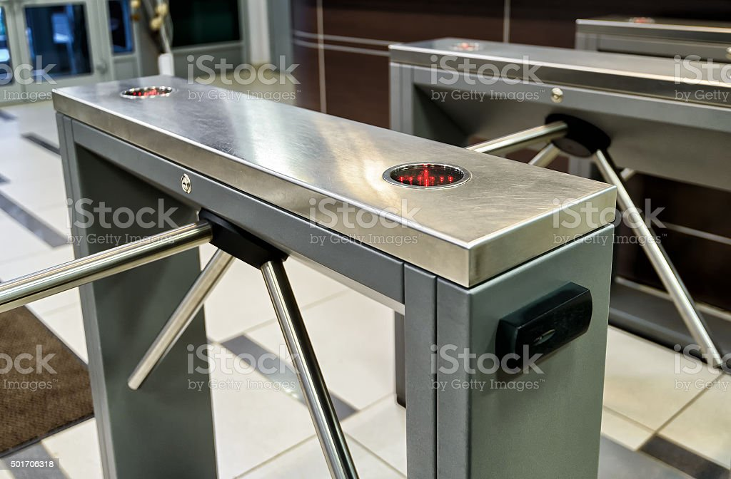 The tripod turnstile with electronic card reader stock photo