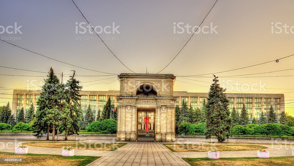 The Triumphal Arch and the Government building in Chisinau stock photo
