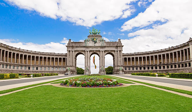The Triumphal Arch in Cinquantenaire Parc in Brussels, Belgium w The Triumphal Arch in Cinquantenaire Parc in Brussels, Belgium with flowers in summer belgium stock pictures, royalty-free photos & images