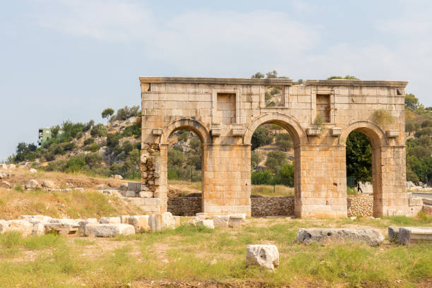 the triumphal arch of metius modestus welcomes visitors at the entrance to the patara site, - gateshead stock photos and pictures