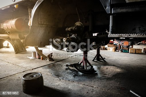 istock The truck during waiting for wheel repair in garage shop with sun light in the morning. Garage concept. 827651652