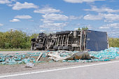 the truck lies on the parties on the route after accident in clear summer day