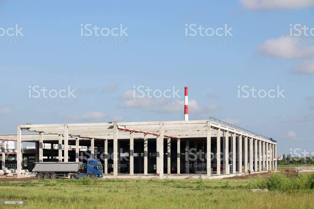 the truck passes by the new factory construction site royalty-free stock photo