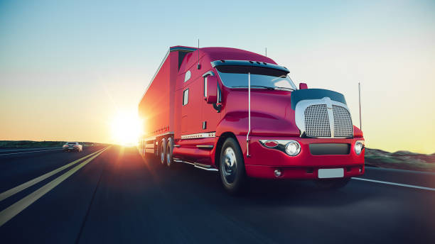 The truck runs on the highway. - foto stock