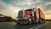 istock The truck runs on the highway with speed. 1249888857