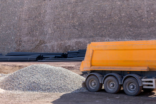 the truck unloads pebbles in the construction site. rounded or partially rounded rock or mineral fragments between 2 and 75 mm in diameter size may be further refined as fine pebbles ( 2-5 mm diameter ). - diameter stock pictures, royalty-free photos & images