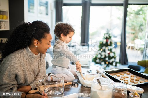 Mother and cute boy at kitchen