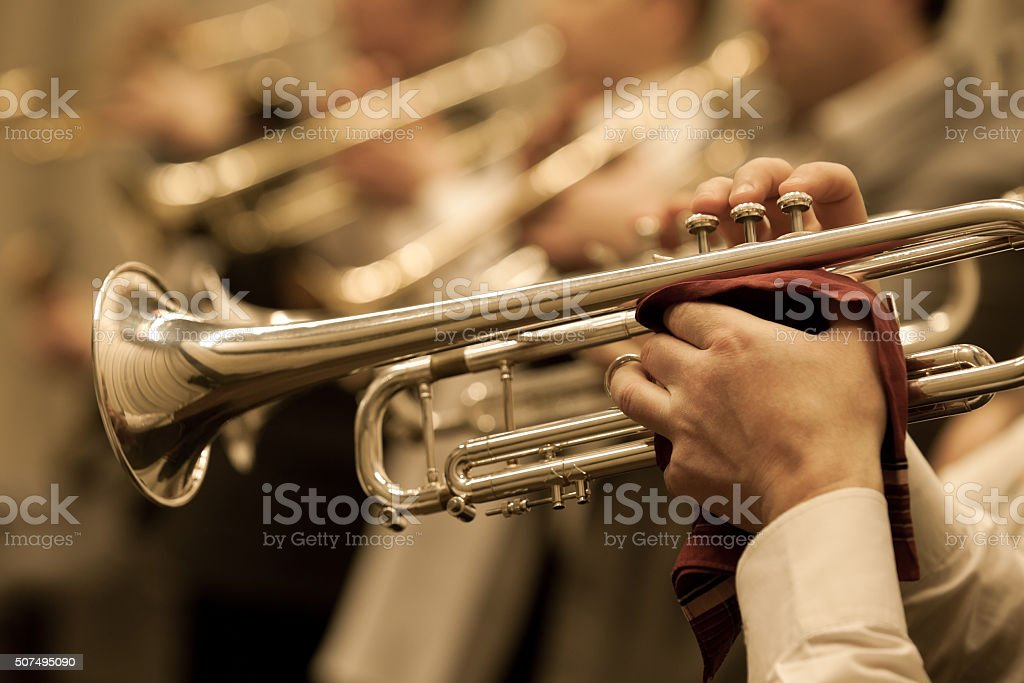 The trumpet in the hands of a musician stock photo