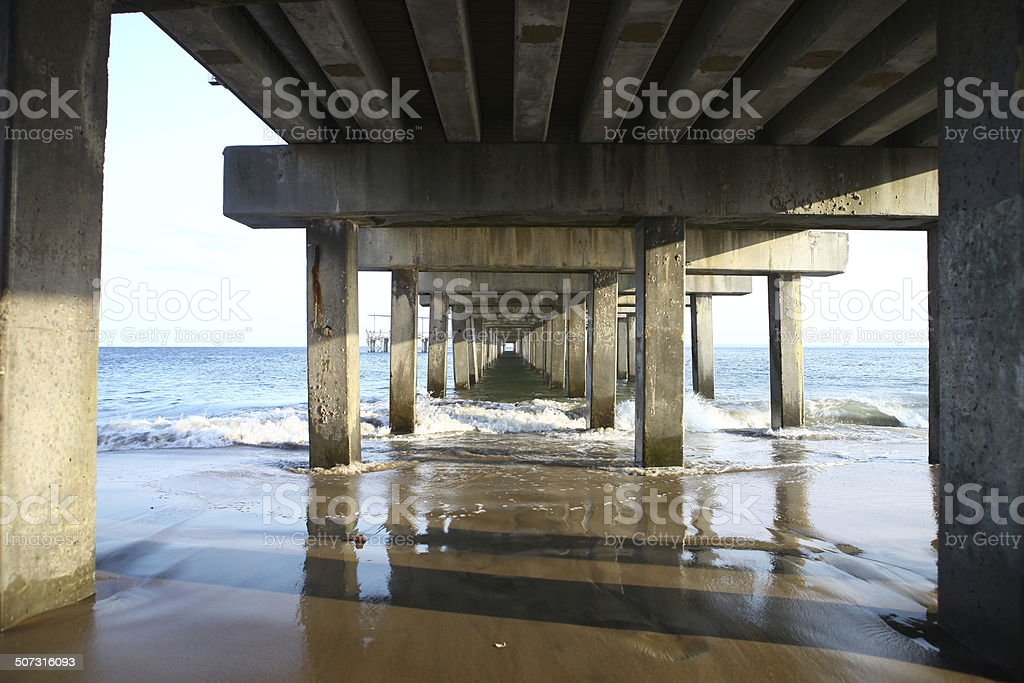 The tunnel under the bridge pier on the ocean stock photo