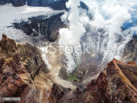 istock The turquoise lake in a crater. Kamchatka, Russia, Mutnovsky Volcano 1288120323
