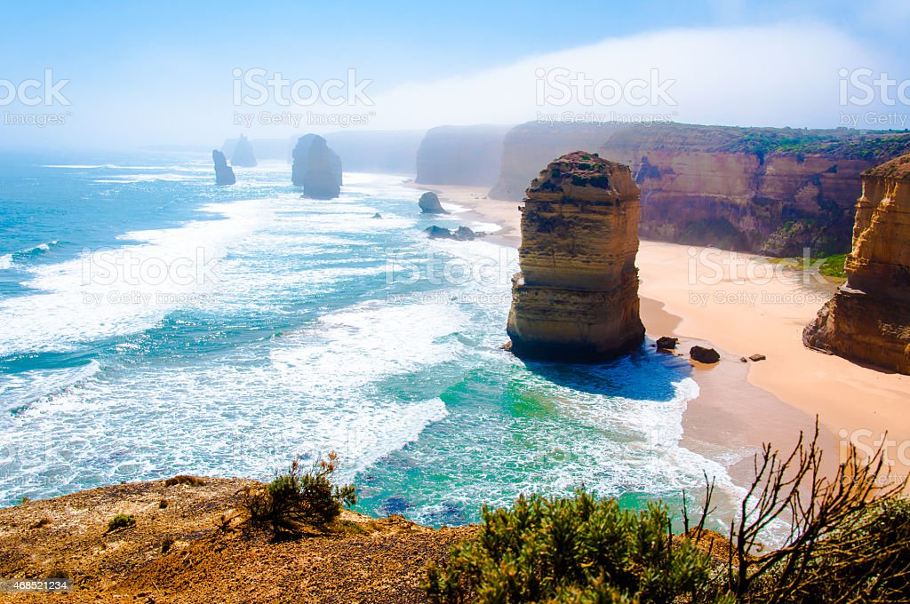 The Twelve Apostles, a famous collection of limestone stacks off the...