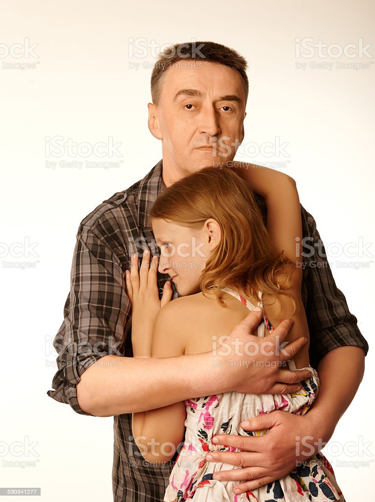 The twelve years daughter hugging father stock photo