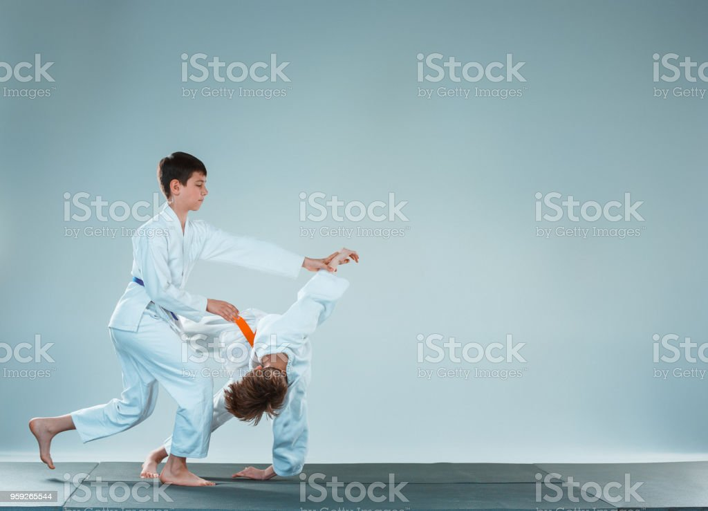 8c0d589144678 The two boys fighting at Aikido training in martial arts school. Healthy  lifestyle and sports concept - Stock image .