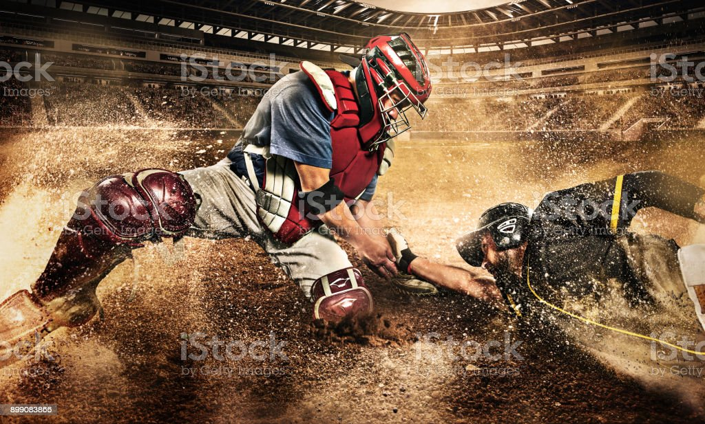 The two caucasian men as baseball players playing against stadium stock photo