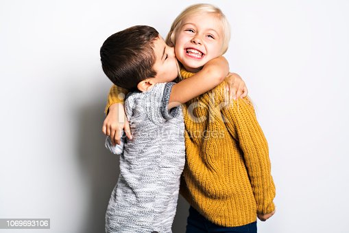 Two Caucasian siblings brother and sister posing