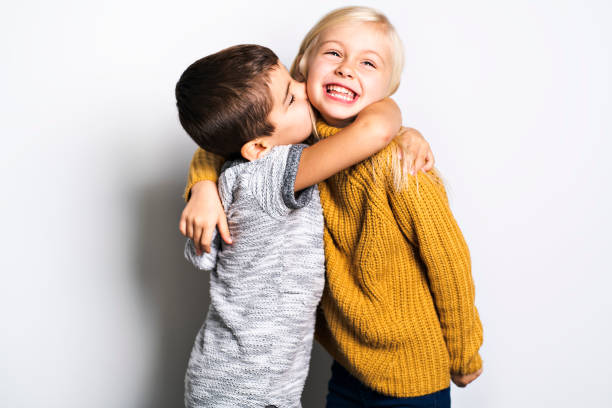 The Two Caucasian siblings brother and sister posing Two Caucasian siblings brother and sister posing brother stock pictures, royalty-free photos & images