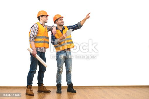 istock The two engineers with a tablet gesture on the white wall background 1060202602