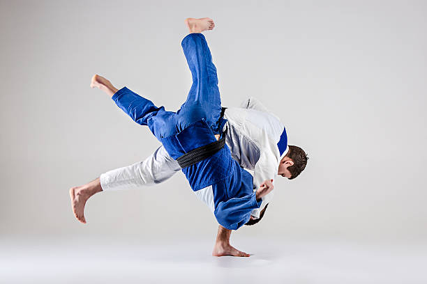 The two judokas fighters fighting men - foto de stock
