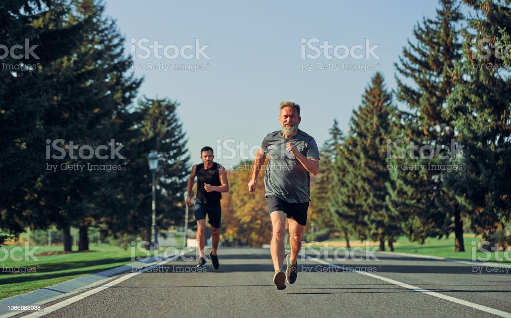 The two sportsmen running on the road