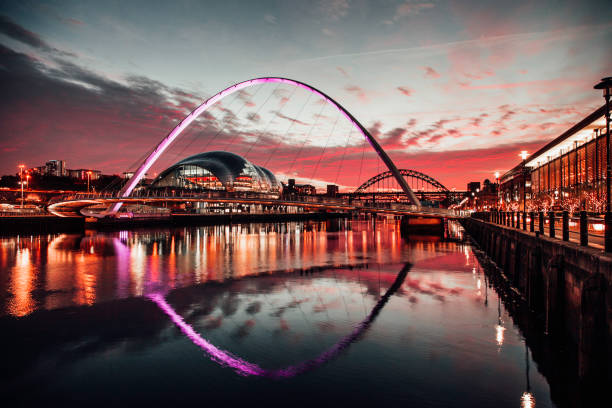 The Tyne Bridges at Sunset A view of the Millennium bridge at sunset with the Tyne Bridge in the background, warm toned northeastern england stock pictures, royalty-free photos & images