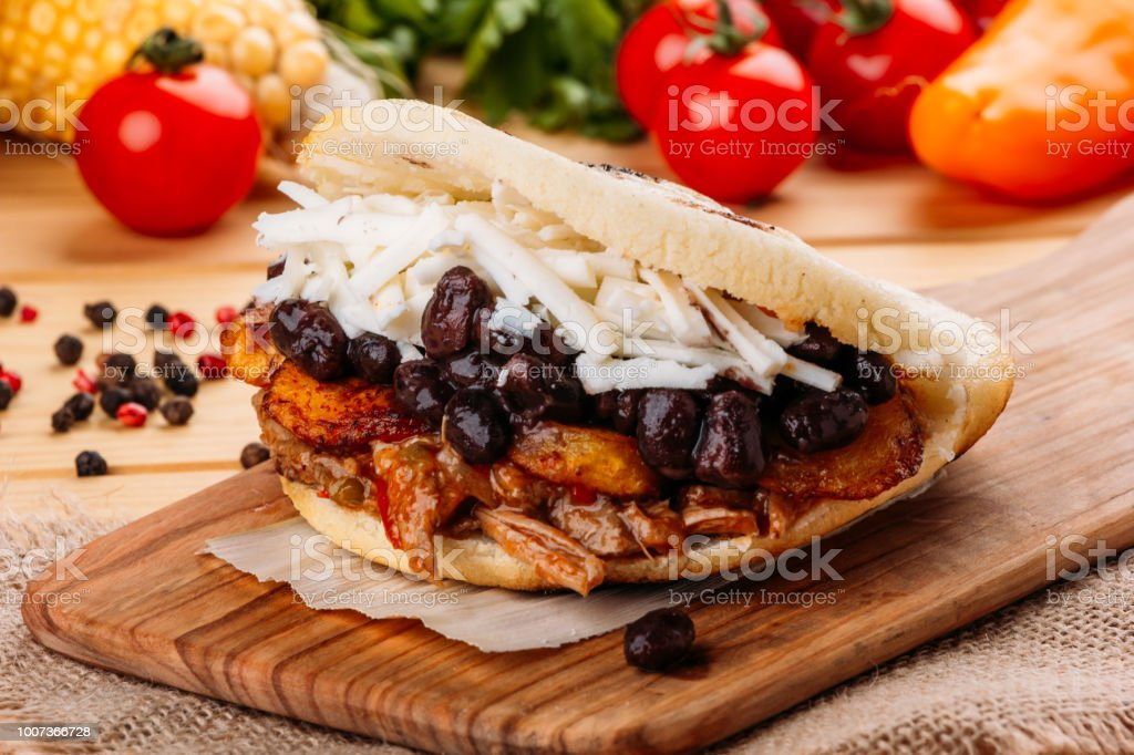 The typical Venezuelan Arepa called Pabellon, which has seasoned minced meat, fried plantain, black beans and white cheese stock photo