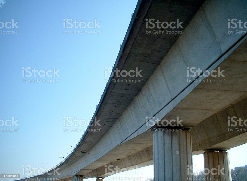 The underside of a flyover bridge on a clear day royalty-free stock photo