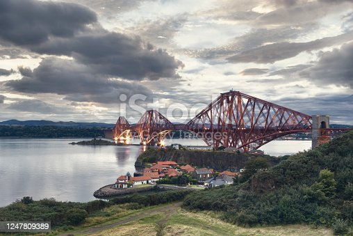 The Forth Bridge is a cantilever railway bridge across the Firth of Forth in the east of Scotland, 9 miles west of central Edinburgh. It is considered as a symbol of Scotland, and is a UNESCO World Heritage Site.