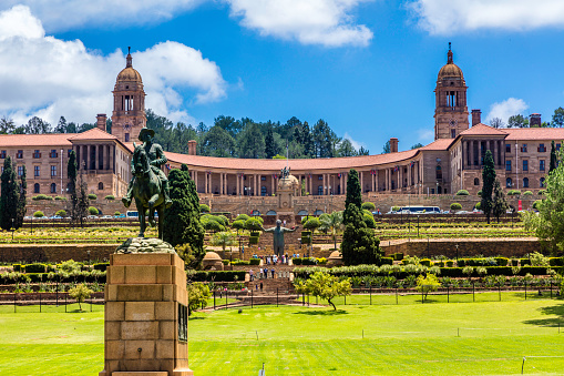 The Union Buildings and gardens in Pretoria, South Africa. This is where parliament is held in South Africa every six months alternatively with Cape Town. Tourists can be seen around Nelson Mandela statue in the centre.