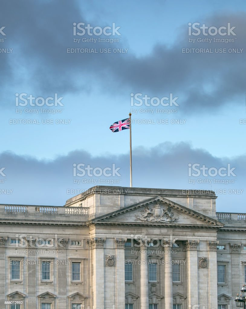 The Union Jack flag fluttering over the World famous Buckingham Palace. stock photo