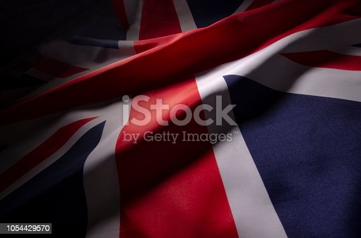 a close up view of Great Britain's flag in shadow and color creating a distinct design