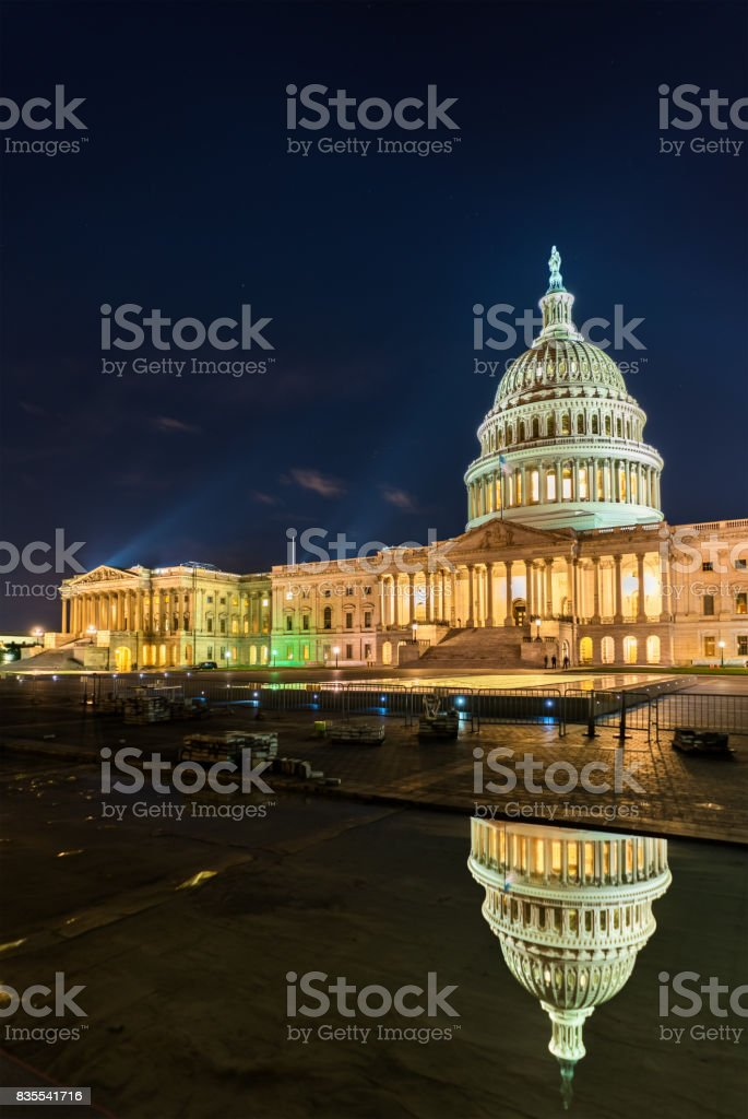 The United States Capitol Building at night in Washington, DC stock photo
